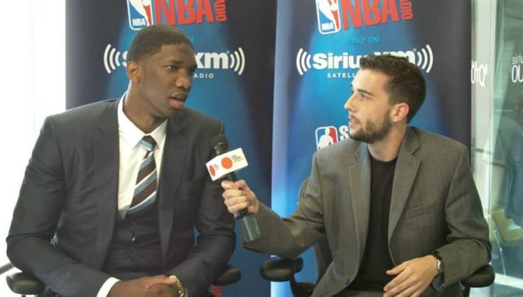 Gleeson interviewing future NBA superstar Joel Embiid before the 2014 NBA draft.