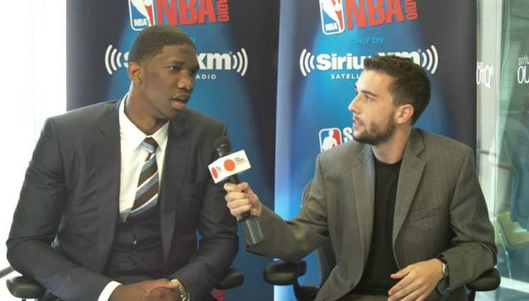 Gleeson interviewing future NBA superstar Joel Embiid before the 2014 NBA draft.